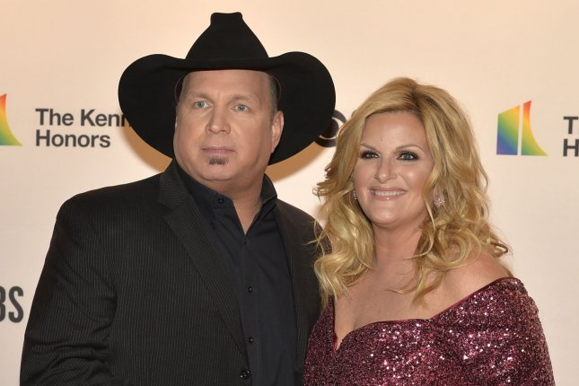 Garth Brooks (L) said his wife and fellow country music star, Trisha Yearwood, tested positive for COVID-19, while he tested negative. File Photo by Mike Theiler/UPI