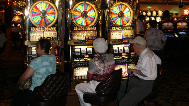 A new federal law requires states to bar the use of cash benefits in liquor stores, gambling establishments and adult entertainment businesses by 2014. (UPI Photo/Daniel Gluskoter).