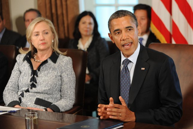 U.S. President Barack Obama speaks at a Cabinet Meeting in the Cabinet Room October 3, 2011 at the White House in Washington, DC. Secretary of State Hillary Clinton listens at left. Obama and Clinton were voted the most admired man and woman living today in a Gallup poll. UPI/Olivier Douliery/Pool