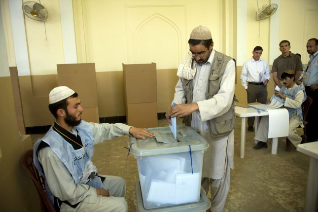 Afghan men cast their ballots for the parliamentary elections in Kabul, Afghanistan, on Saturday, September 18, 2010. Militants struck throughout the country trying to stop the voting. (UPI/Hossein Fatemi)