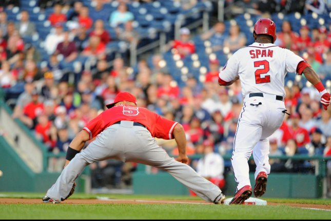 Washington Nationals center fielder Denard Span (2) is thrown out at first base as Los Angeles Angels first baseman Albert Pujols (5) takes the throw in the first inning at Nationals Park in Washington, D.C. on April 21, 2014. UPI/Mark Goldman