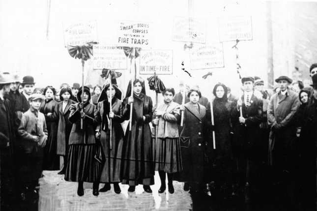 """Women protest after the Triangle Shirtwasit Factory fire which occurred on March 25, 1911. They hold signs advocating for fire drills in every shop, an end to political graft, no more long days spent working in fire traps"""" and the importance of unions. UPI/Cornell University"""