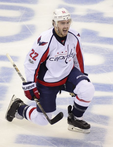 Kevin Shattenkirk of the Washington Capitals celebrates a goal. Shettenkirk has signed a free-agent contract with the New York Rangers. Photo by Archie Carpenter/UPI