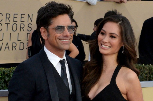 John Stamos (L), pictured with Caitlin McHugh, introduced his son to Bob Saget and Lori Loughlin on Thursday. File Photo by Jim Ruymen/UPI