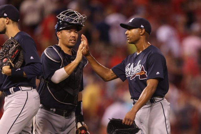 Atlanta Braves pitcher Sam Freeman and catcher Kurt Suzuki celebrate the third out and a 11-4 win over the St. Louis Cardinals on June 30 at Busch Stadium in St. Louis. Photo by Bill Greenblatt/UPI