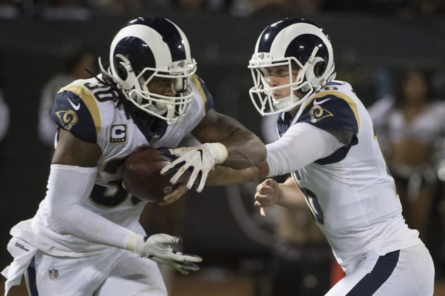 Los Angeles Rams quarterback Jared Goff (R) hands off to Todd Gurley II (30) in the third quarter against the Oakland Raiders on September 10, 2018 at the Coliseum in Oakland, California. Photo by Terry Schmitt/UPI