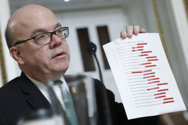 House rules committee Chairman Jim McGovern, D-Mass., holds up a list of people and organizations who have not cooperated with the impeachment investigation. Photo by Andrew Harnik/UPI
