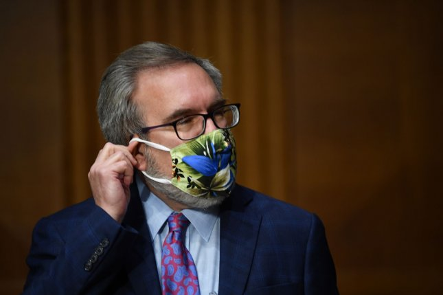 EPA Administrator Andrew Wheeler adjusts his mask at an oversight hearing Wednesday on Capitol Hill. Photo by Kevin Dietsch/UPI