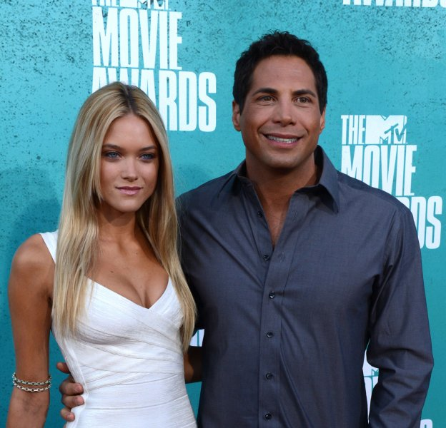 Joe Francis (R) and guest arrive at the MTV Movie Awards at the Gibson Amphitheatre in Universal City, California on June 3, 2012. UPI/Jim Ruymen