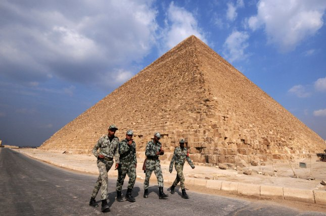 Egyptian army soldiers walking near pyramids in Egypt, on February 9, 2011, the 16th day of consecutive protests calling for the ouster of President Hosni Mubarak. UPI