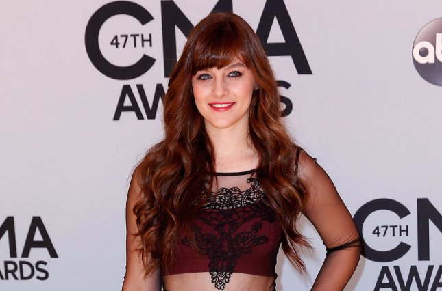 Aubrey Peeples arrives on the red carpet at the 47th Annual Country Music Awards at the Bridgestone Arena in Nashville, November 6, 2013. UPI/Terry Wyatt