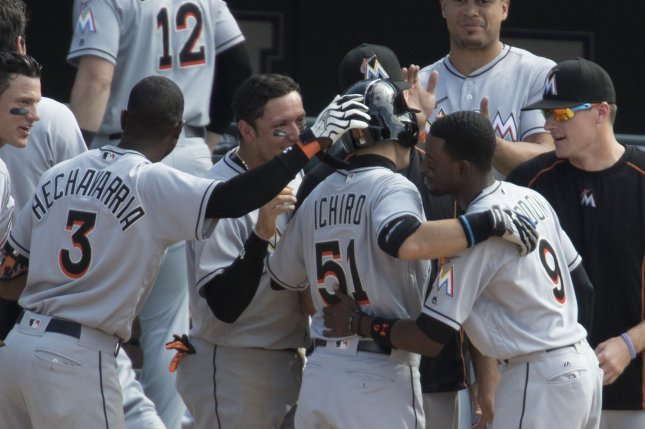 Teammates congratulate Miami Marlins outfielder Ichiro Suzuki after his seventh inning triple put him at 3,000 hits at Coors Field in Denver on August 7, 2016. Ichiro becomes the 30th player in Major League history to record 3,000hits. Photo by Gary C. Caskey/UPI