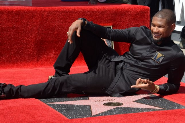 Usher receives his star on the Hollywood Walk of Fame on Wednesday. Photo by Jim Ruymen/UPI