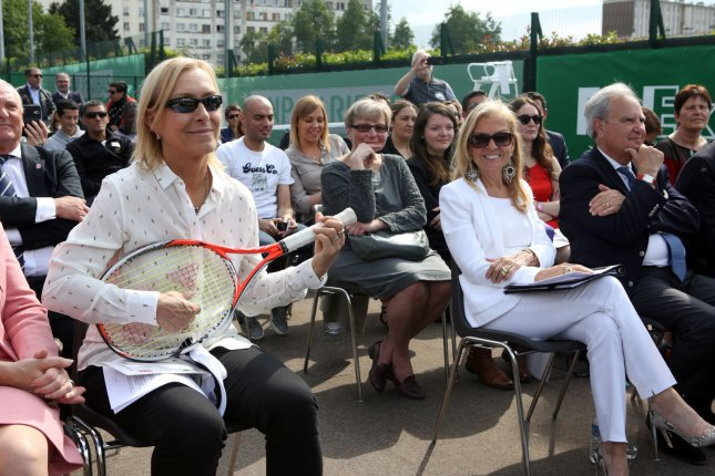 Former U.S. Ambassador to France Jane Hartley (R) looks on as tennis star Czech-born U.S. national Martina Navratilova pretends to play the guitar with a tennis raquet during the inauguration of tennis courts in 2016 in Aubervilliers, a suburb north of Paris. File photo by Maya Vidon-White/UPI