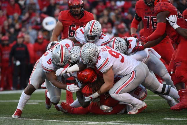 Ohio State Buckeyes defensive end Nick Bosa (97) helps make a tackle against the Maryland Terrapins. File photo by Molly Riley/UPI