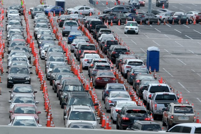 Residents wait in their vehicles to be tested for COVID-19 at Hard Rock Stadium in Miami, Fla., on July 2.Health officials say about half of all Florida intensive care units are at least 90 percent full.Photo by Gary I Rothstein/UPI