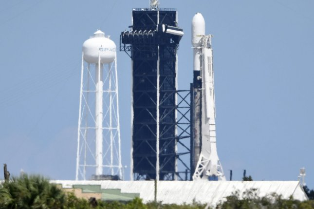 A SpaceX Falcon 9 rocket stands ready to launch another cluster of the company's Starlink satellites from Kennedy Space Center in Florida on Monday. Photo by Joe Marino/UPI
