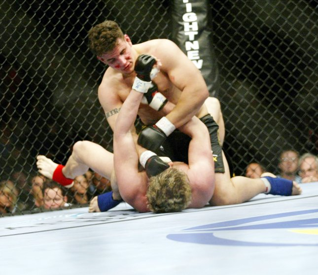 An analysis of UFC fights suggests judges are more likely to award victory to aggressive fighters rather than skilled fighters. File Photo by Roger Williams/UPI