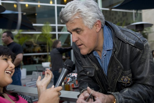 Talk Show Host Jay Leno talks with a young reporter as he arrives to the premiere of One Two Many in Los Angeles on April 10, 2008. (UPI Photo/Hector Mata)