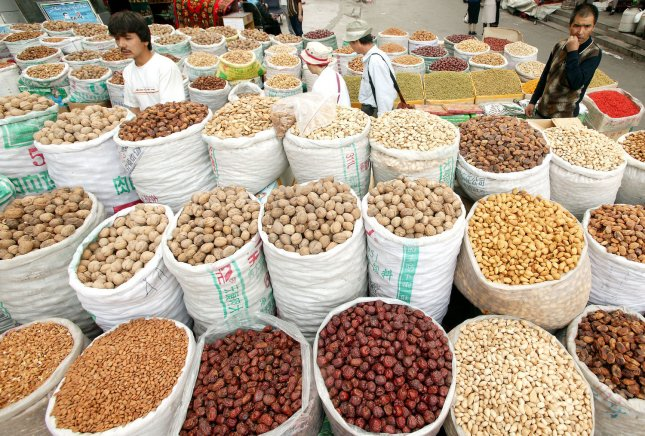 A couple of handfuls of walnuts a day may help prevent prostate cancer. Nuts of all kinds are displayed for sale at a Uighur market in China. (UPI Photo/Stephen Shaver)