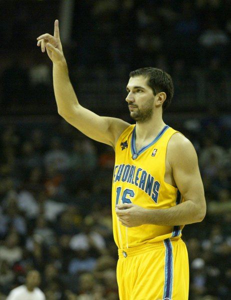 2c79712cbbf New Orleans Hornets forward Peja Stojakovic (16), of Serbia, calls a play  as the Hornets play the Charlotte Bobcats at the Charlotte Bobcats Arena in  ...