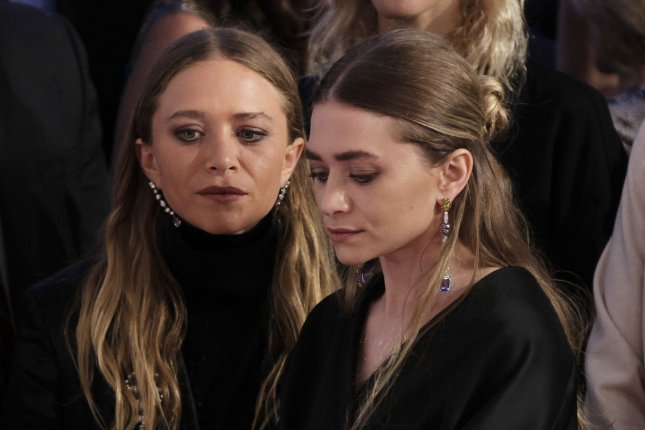 Mary-Kate Olsen (L) and Ashley Olsen at the CFDA Fashion Awards on June 1. The sisters may still join Netflix series 'Fuller House.' File photo by John Angelillo/UPI