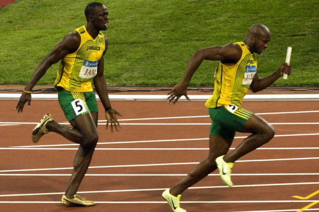 Jamaica's Usain Bolt, L, screams at teammate Asafa Powell after handing him the baton for the last leg of the men's 4x100-meter relay final during the Beijing 2008 Olympic Games on August 22, 2008. The team won the gold but the team was stripped of the medal Wednesday when Nesta Carter tested positive for a banned substance. File photo by Stephen Shaver/UPI