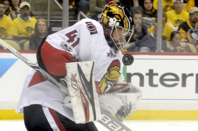 The Pittsburgh Penguins' shot bounces off the chest of Ottawa Senators goalie Craig Anderson (41). File photo by Archie Carpenter/UPI