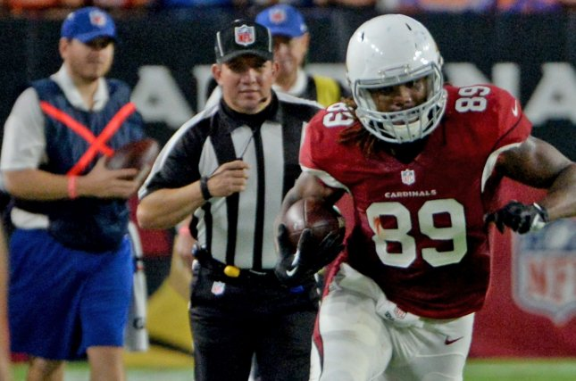 Former Arizona Cardinals tight end Hakeem Valles (R). File photo by Art Foxall/UPI
