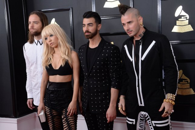 Joe Jonas (second from right) with Jack Lawless, JinJoo Lee and Cole Whittle (L-R) of DNCE at the Grammy Awards on February 12. The singer recently discussed the possibility of a new Camp Rock sequel. File Photo by Jim Ruymen/UPI