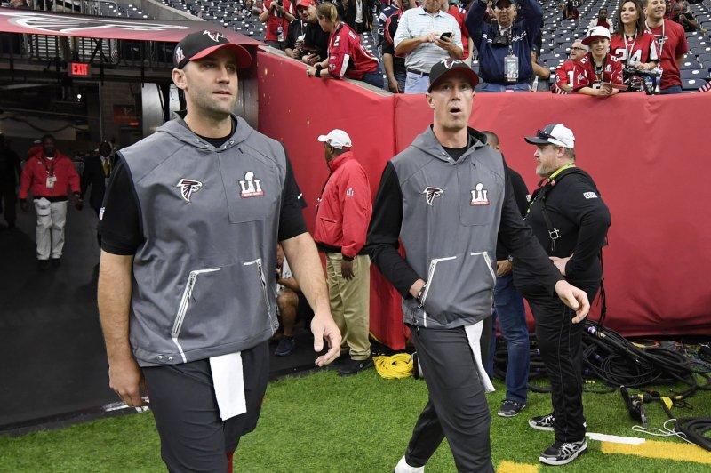 Atlanta Falcons quarterback Matt Ryan and backup quarterback Matt Schaub walk onto the field during pregame events before Super Bowl LI at NRG Stadium in Houston on February 5, 2017. Photo by Brian Kersey/UPI