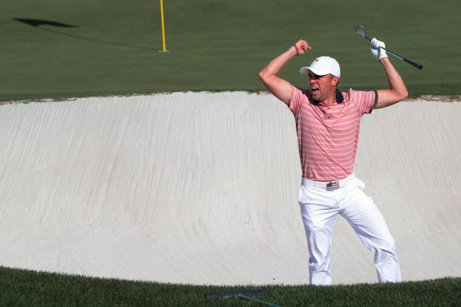 Justin Thomas of the United States reacts after sinking the ball from the bunker on the 14th green on day two of the Presidents Cup on Friday at Liberty National Golf Club in Jersey City, N.J. Photo by Rich Schultz/UPI