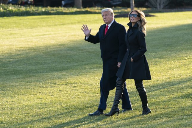 United States President Donald Trump and first lady Melania Trump depart the White House in Washington, D.C., on December 23 for his Florida Mar-a-Lago resort. Photo by Chris Kleponis/UPI
