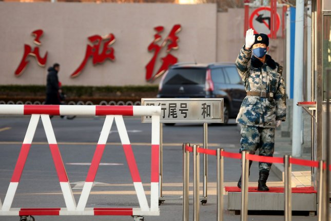 A Chinese soldier wears a protective mask in Beijing on January 23, 2020, the same day the government issued lockdown orders for the city of Wuhan over a coronavirus outbreak. File Photo by Stephen Shaver/UPI