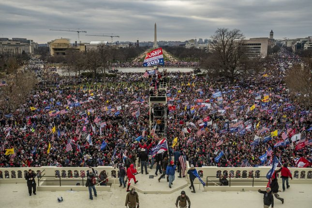 Pro-Trump rioters breach the security perimeter and penetrate the U.S. Capitol to protest against the Electoral College vote count that would certify President-elect Joe Biden as the winner in Washington, D.C., on January 6. File Photo by Ken Cedeno/UPI