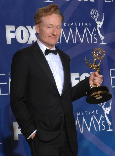 Conan O'Brien appears backstage with the Emmy he won for work on 'Late Night' at the 59th Primetime Emmy Awards at the Shrine Auditorium in Los Angeles on September 16, 2007. (UPI Photo/Scott Harms)