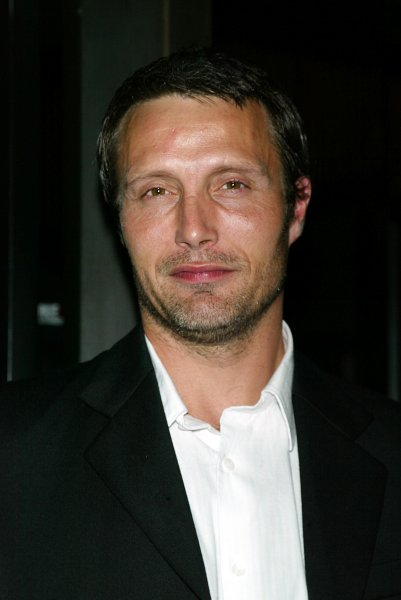 Mads Mikkelson poses for pictures at the premiere of King Arthur at the Zeigfeld Theater in New York on June 28, 2004. (UPI Photo/Laura Cavanaugh)