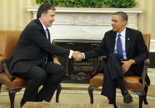 U.S. President Barack Obama (R) shakes hands with Georgian President Mikheil Saakashvili after a bilateral meeting in the Oval Office of the White House, January 30, 2012, Washington, DC. The two leaders discussed Georgia's contributions to security in Afghanistan as well as mutual cooperation in trade, tourism, energy, science and culture. UPI/Mike Theiler