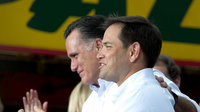 Republican presidential nominee Mitt Romney is introduced by Senator Marco Rubio (R) before delivering remarks to supporters in Miami, Florida on August 13, 2012. File/UPI/Gary I Rothstein