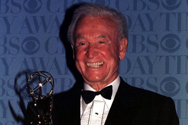Bob Barker (The Price is Right) poses with his Lifetime Achievement Emmy Award at the 1999 Daytime Emmy Award ceremonies. (Ezio Petersen/UPI)