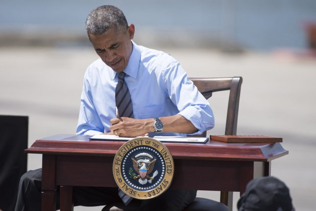 President Barack Obama signs an initiative to increase private sector investment into the Nation's infrastructure, at the Port of Wilmington on July 17, 2014 in Wilmington, Delaware. UPI/Kevin Dietsch