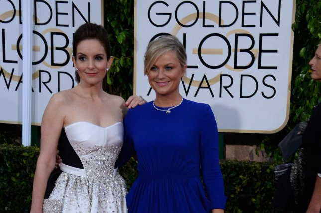 Tina Fey, left, and Amy Poehler hosted the 72nd annual Golden Globe Awards at the Beverly Hilton Hotel. Photo by Jim Ruymen/UPI
