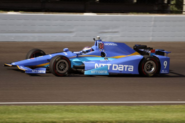 Former winner Scott Dixon speeds through the north short chute during day 2 practice at the Indianapolis Motor Speedway on May 16, 2017 in Indianapolis, Indiana. He won his third career pole for the race. Dixon won the 500 in 2008. Photo by Bill Coons/UPI