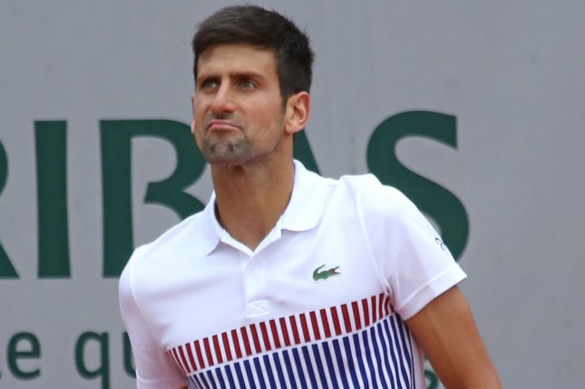 Novak Djokovic of Serbia reacts after a shot during his French Open men's quarterfinal match against Dominic Thiem of Austria at Roland Garros in Paris on June 7, 2017. Thiem defeated Djokovic 7-6 (5), 6-3, 6-0 to advance to the semifinals. Photo by David Silpa/UPI