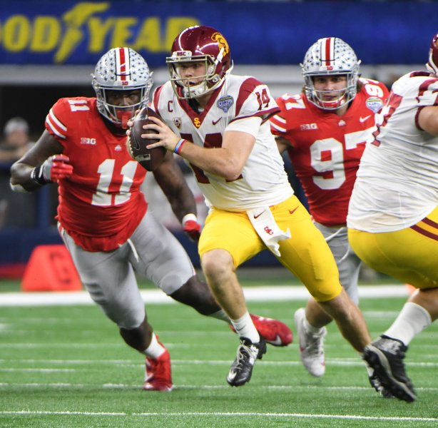 USC quarterback Sam Darnold rushes against Ohio State during the first half of the Goodyear Cotton Bowl Classic on Dec. 29 at AT&T Stadium in Arlington, Texas. Photo by Ian Halperin/UPI
