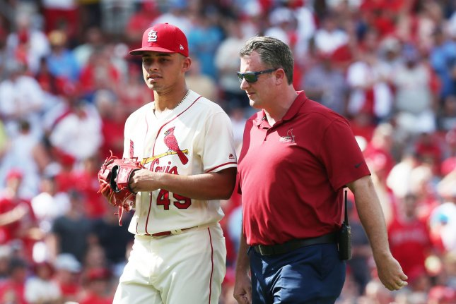 St. Louis Cardinals relief pitcher Jordan Hicks (L) leaves the game with athletic trainer Chris Conroy after suffering an injury in the ninth inning against the Los Angeles Angels on Saturday at Busch Stadium in St. Louis. Photo by Bill Greenblatt/UPI
