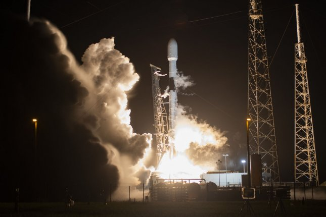A SpaceX Falcon 9 rocket boosts the company's Starlink satellites to orbit Wednesday from the Cape Canaveral Air Force Station. Photo by Joe Marino/UPI