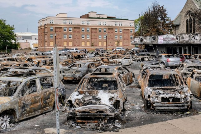 The remains of vehicles are on the lot of Car Source, a pre-owned vehicle dealership, are shown on Aug. 31, after they were torched by protesters during demonstrations against the shooting in the back of Jacob Blake, an unarmed Black man last week in Kenosha, Wisconsin. Photo by Alex Wroblewski/UPI