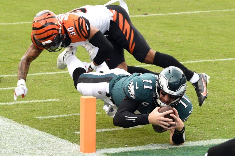 Philadelphia Eagles quarterback Carson Wentz (11) dives past Cincinnati Bengals free safety Jessie Bates (30) for a touchdown during the second half. Photo by Derik Hamilton/UPI