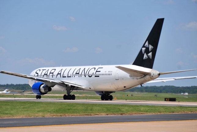 A United Airlines flight with livery of the Star Alliance is pictured at Dulles International Airport in Dulles, Va., near Washington, D.C. File Photo by Kevin Dietsch/UPI